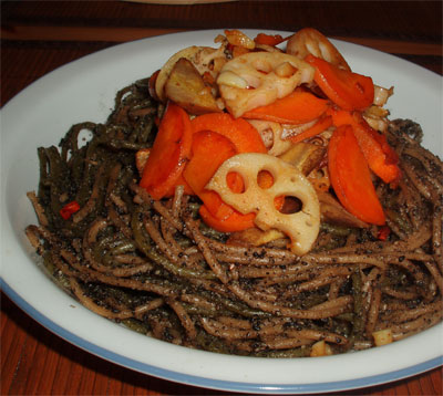 black sesame spagetti with root vegetables